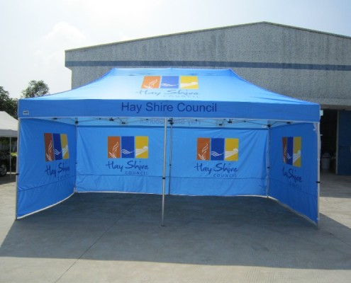 Blue Marquee with printed roof and walls